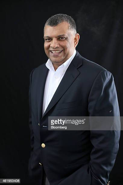 Tony Fernandes chief executive officer of AirAsia Bhd poses for a photograph following a Bloomberg Television interview on day two of the World...
