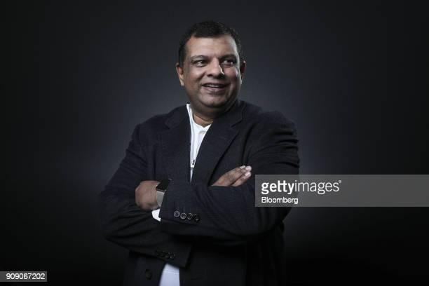 Tony Fernandes chief executive officer of AirAsia Bhd poses for a photograph following a Bloomberg Television interview on the opening day of the...