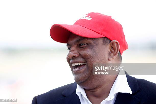 Tony Fernandes chief executive officer of AirAsia Bhd reacts during a Bloomberg Television interview at the Airbus Group NV chalet on the second day...
