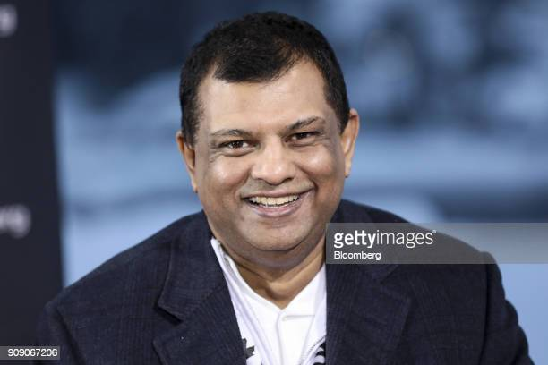 Tony Fernandes chief executive officer of AirAsia Bhd reacts during a Bloomberg Television interview on the opening day of the World Economic Forum...