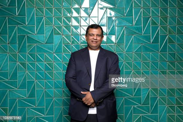 Tony Fernandes group chief executive officer of AirAsia Bhd poses for a photograph on the sidelines of the Milken Institute Asia Summit in Singapore...
