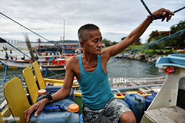 Tony Fernandez a Filipino fisherman on his boat supervising preparations for another fishing trip to the Spratlys on July 10 2016 in Mariveles Bataan...