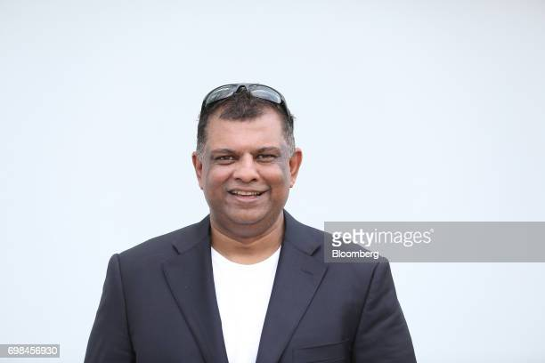 Tony Fernandez group chief executive officer of AirAsia Bhd poses for a photograph during the 53rd International Paris Air Show at Le Bourget in...