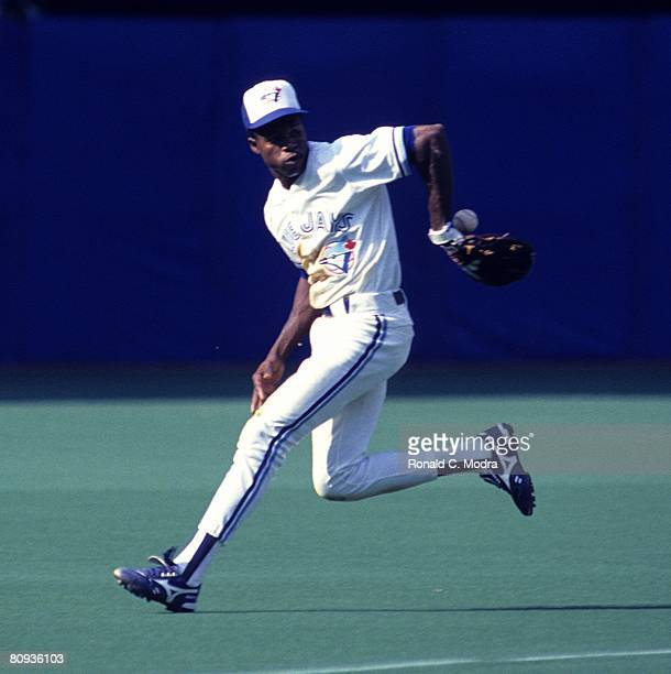 Tony Fernandez of the Toronto Blue Jays fields a ball during a game against the Boston Red Sox on August 25 1990 in Toronto Ontario Canada