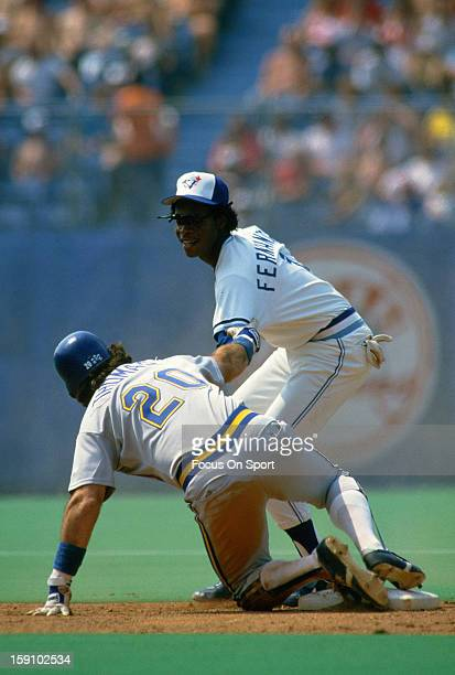 Tony Fernandez of the Toronto Blue Jays gets the force out on Gorman Thomas of the Milwaukee Brewers during an Major League Baseball game circa 1986...