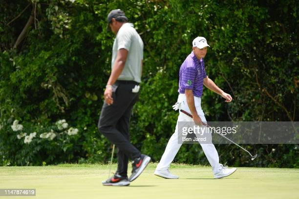 Tony Finau and Jim Furyk read the seventh green during the final round of the Charles Schwab Challenge at Colonial Country Club on May 26 2019 in...