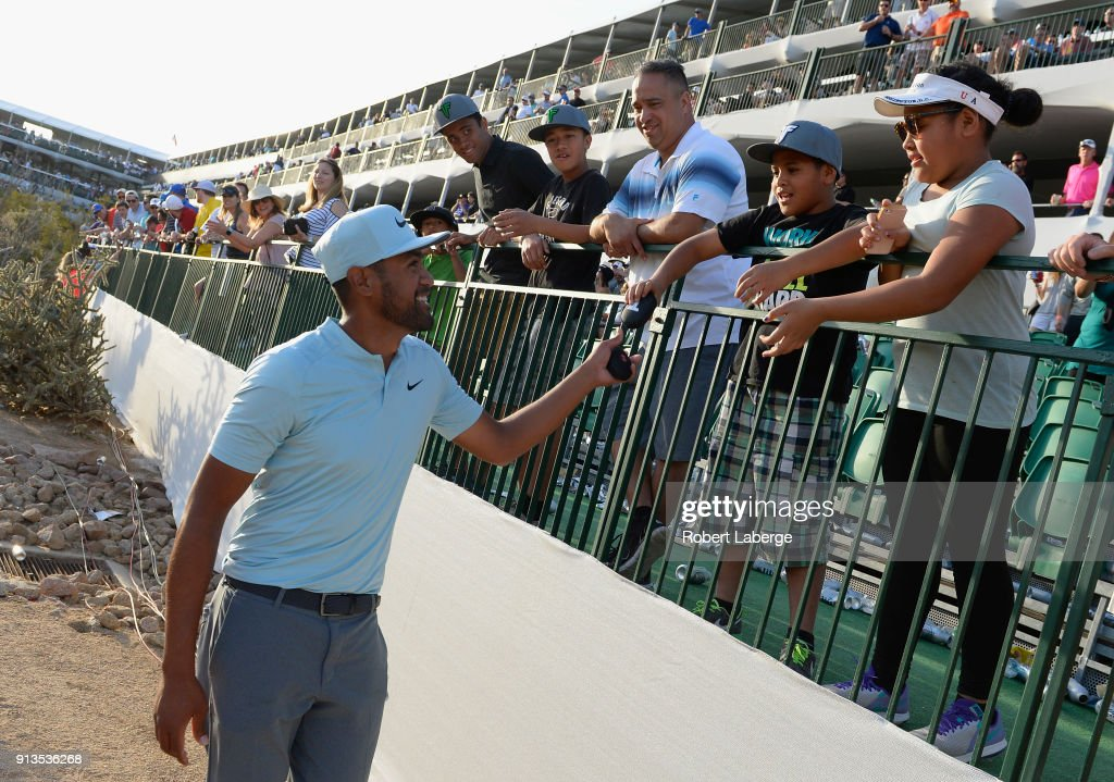 Tony Finau hands out 'BEATS' headphones on the 16th hole during the second round of the Waste Management Phoenix Open at TPC Scottsdale on February 2, 2018 in Scottsdale, Arizona.