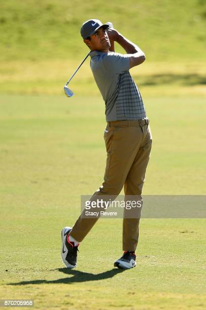 Tony Finau hits his approach shot on the ninth hole during the third round of the Shriners Hospitals For Children Open at the TPC Summerlin on...
