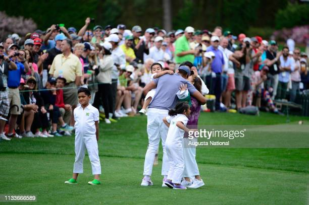Tony Finau is hugged after he nearly ran out of his shoes on No 7 during the Par 3 Contest at Augusta National Golf Club Wednesday April 4 2018