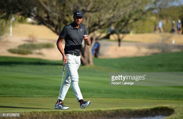 Tony Finau lines up a putt on the sixth hole during the first round of the Waste Management Phoenix Open at TPC Scottsdale on February 1 2018 in...