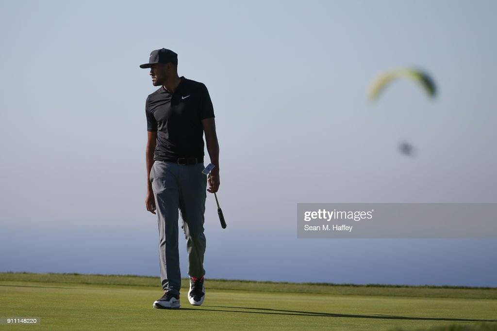 Tony Finau looks over his putt on the 14th green during the third round of the Farmers Insurance Open at Torrey Pines South on January 27, 2018 in San Diego, California.