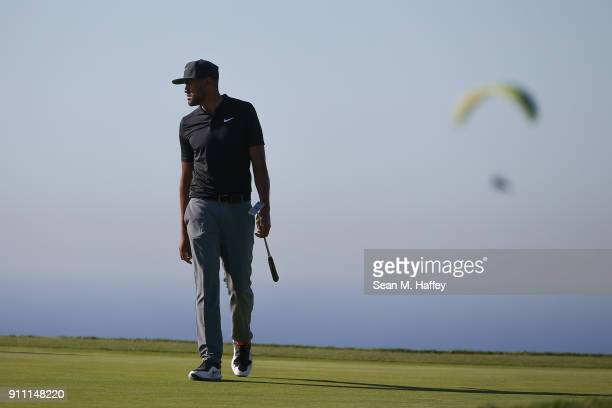 Tony Finau looks over his putt on the 14th green during the third round of the Farmers Insurance Open at Torrey Pines South on January 27 2018 in San...