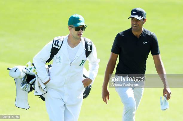 Tony Finau of the United States and caddie Gregory Bodine on the 11th green during the first round of the 2018 Masters Tournament at Augusta National...