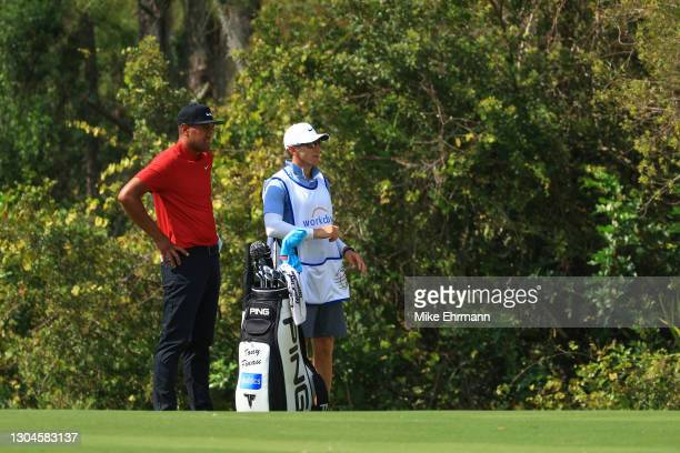 Tony Finau of the United States and his caddie wait on the seventh hole during the final round of World Golf Championships-Workday Championship at...