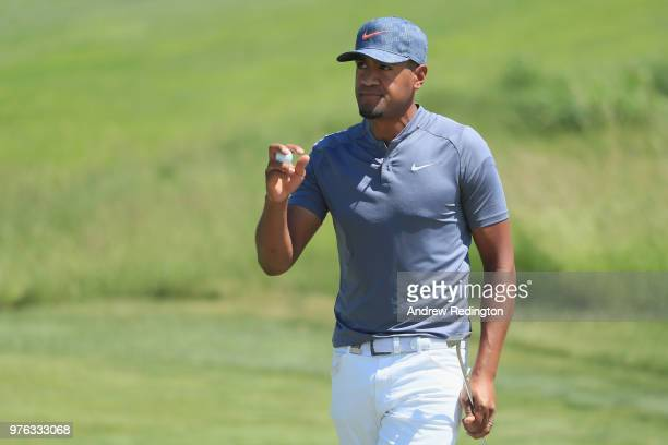 Tony Finau of the United States celebrates after making a birdie putt on the 18th green during the third round of the 2018 US Open at Shinnecock...