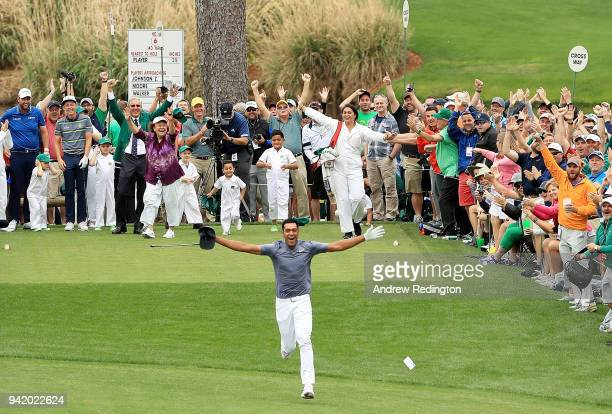 Tony Finau of the United States celebrates his holeinone on the seventh hole during the Par 3 Contest prior to the start of the 2018 Masters...