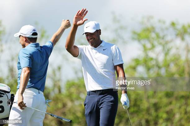 Tony Finau of the United States celebrates his hole-in-one with Emiliano Grillo of Argentina on the fourth tee during the third round of the Mayakoba...