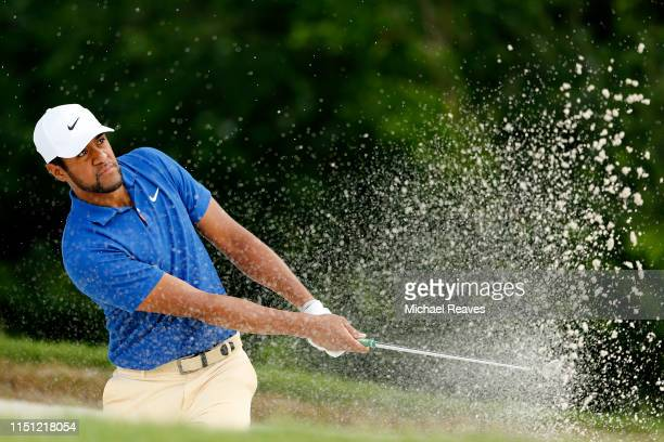 Tony Finau of the United States plays a shot from a bunker on the fifth hole during the first round of the Charles Schwab Challenge at Colonial...