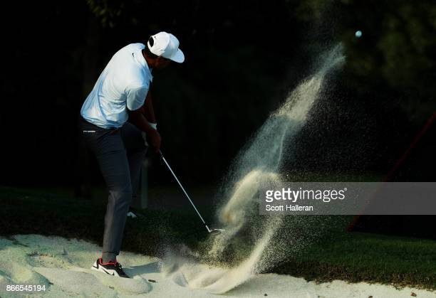 Tony Finau of the United States plays a shot from a bunker on the 18th hole during the first round of the WGC HSBC Champions at Sheshan International...