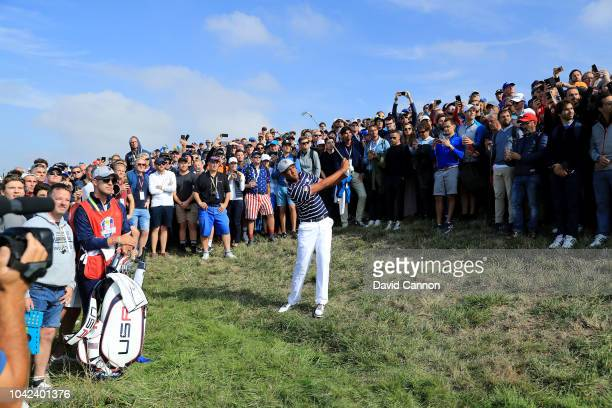 Tony Finau of the United States plays his second shot on the 17th hole in his match with Brooks Koepka against Justin Rose and Jon Rahm of the...