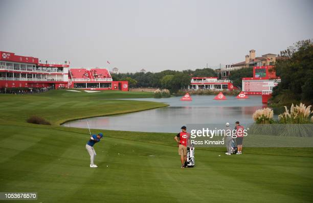Tony Finau of the United States plays his second shot on the 18th hole during the second round of the WGC HSBC Champions at Sheshan International...