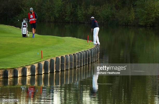 Tony Finau of the United States plays his second shot on the 1st hole during the morning fourball matches of the 2018 Ryder Cup at Le Golf National...