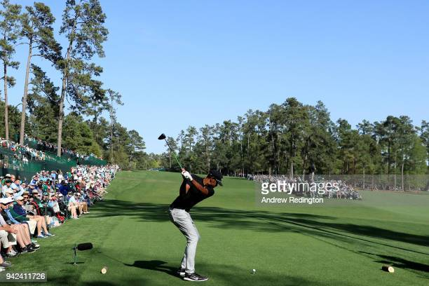 Tony Finau of the United States plays his shot from the 14th tee during the first round of the 2018 Masters Tournament at Augusta National Golf Club...