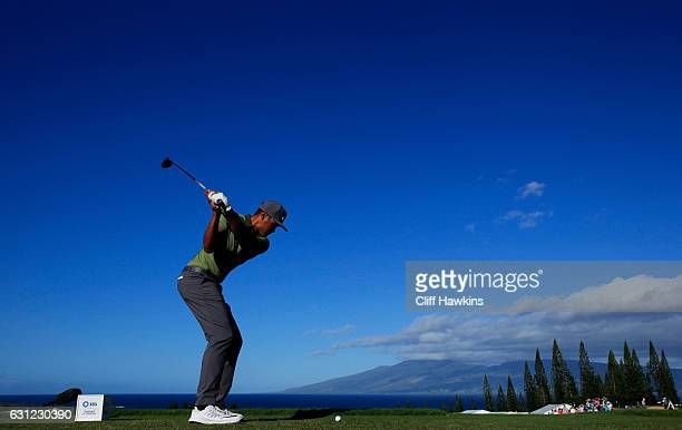 Tony Finau of the United States plays his shot from the first tee during the final round of the SBS Tournament of Champions at the Plantation Course...