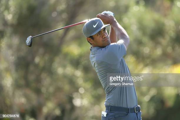 Tony Finau of the United States plays his shot from the first tee during round two of the Sony Open In Hawaii at Waialae Country Club on January 12...