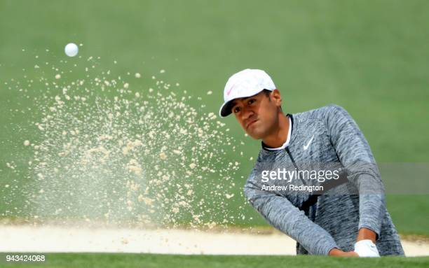 Tony Finau of the United States plays his third shot from a bunker on the second hole during the final round of the 2018 Masters Tournament at...