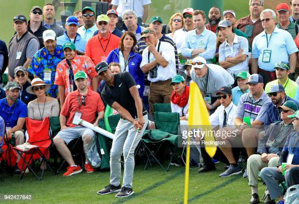 Tony Finau of the United States plays his third shot on the 18th hole during the first round of the 2018 Masters Tournament at Augusta National Golf...