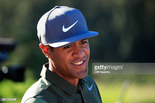 Tony Finau of the United States prepares to play from the first tee during the final round of the SBS Tournament of Champions at the Plantation...
