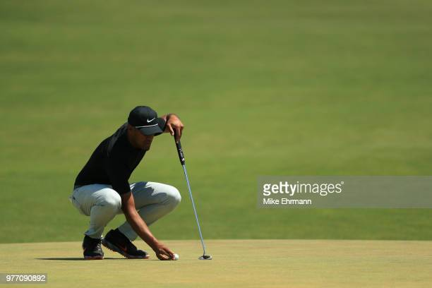 Tony Finau of the United States prepares to putt on the first green during the final round of the 2018 US Open at Shinnecock Hills Golf Club on June...