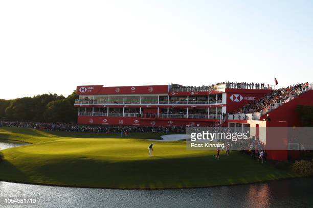 Tony Finau of the United States putts on the 18th green during a playoff in the final round of the WGC HSBC Champions at Sheshan International Golf...