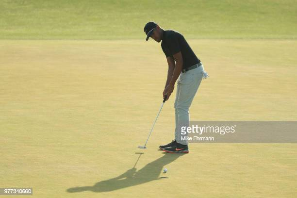 Tony Finau of the United States putts on the 18th green during the final round of the 2018 US Open at Shinnecock Hills Golf Club on June 17 2018 in...