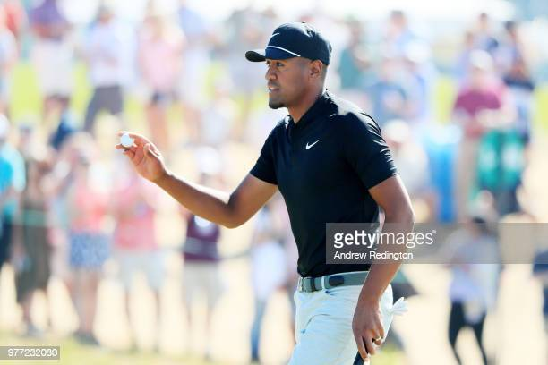 Tony Finau of the United States reacts after making a birdie putt on the ninth green during the final round of the 2018 US Open at Shinnecock Hills...