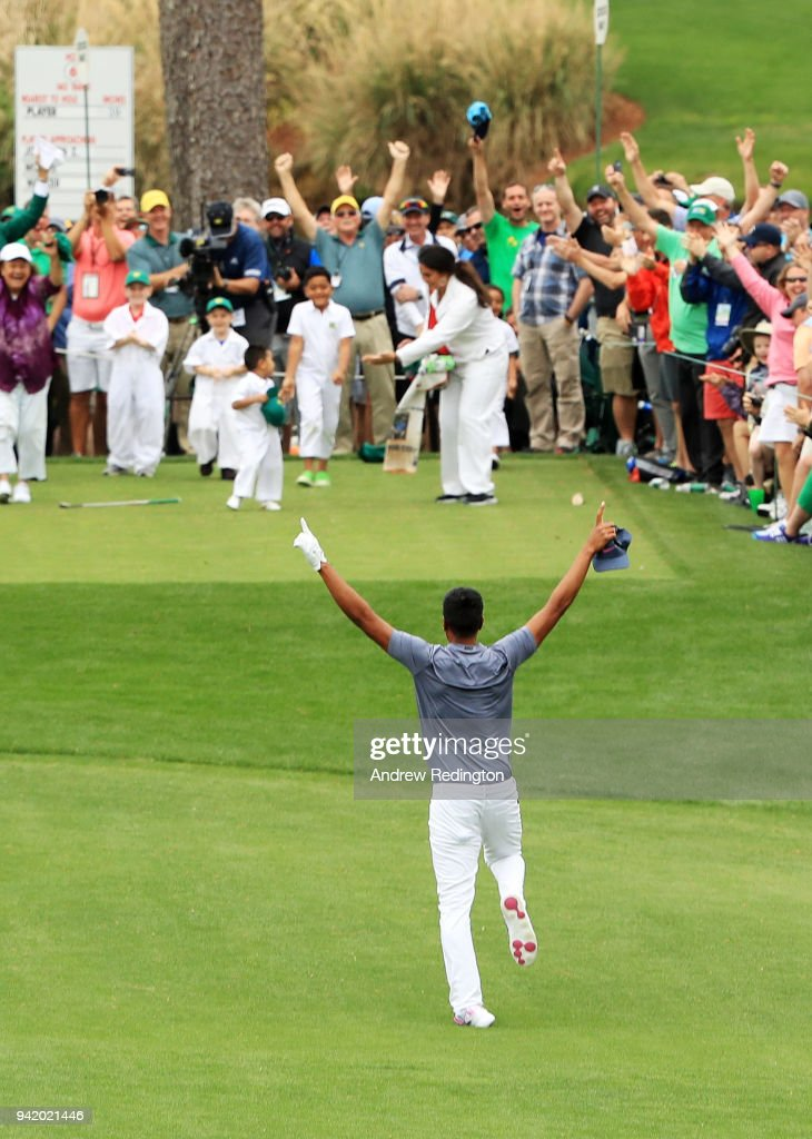 Tony Finau of the United States rolls his ankle as he celebrates his hole-in-one on the seventh hole during the Par 3 Contest prior to the start of the 2018 Masters Tournament at Augusta National Golf Club on April 4, 2018 in Augusta, Georgia.