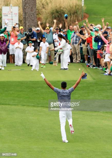 Tony Finau of the United States rolls his ankle as he celebrates his holeinone on the seventh hole during the Par 3 Contest prior to the start of the...