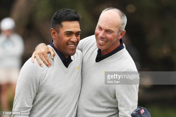 Tony Finau of the United States team and Matt Kuchar of the United States team react on the 18th green after halving their match with ByeongHun An of...