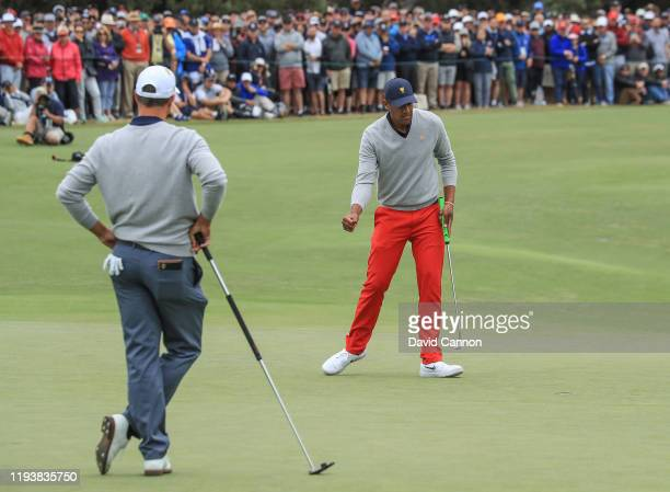 Tony Finau of the United States Team celebrates holing a birdie putt on the 18th hole to tie his match with Matt Kuchar against Adam Scott and Byeong...