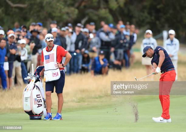 Tony Finau of the United States Team hits his second shot on the 18th hole in his match with Mattt Kuchar against Byeong Hun An and Joaquin Niemann...