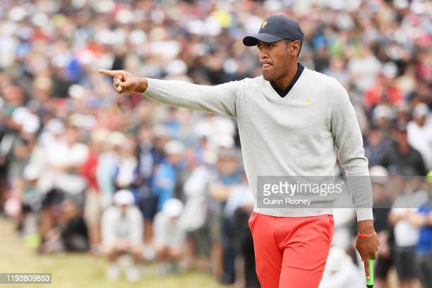 Tony Finau of the United States team reacts on the 14th green during Saturday four-ball matches on day three of the 2019 Presidents Cup at Royal...