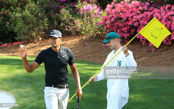 Tony Finau of the United States waves after making a birdie on the 13th green during the first round of the 2018 Masters Tournament at Augusta...
