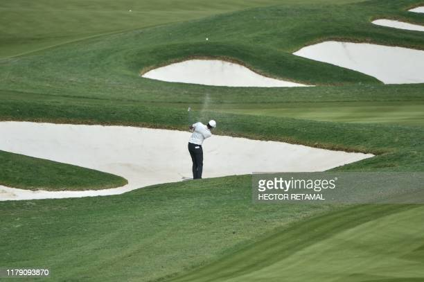 Tony Finau of the US plays a shot during the WGC-HSBC Champions golf tournament in Shanghai on October 31, 2019.