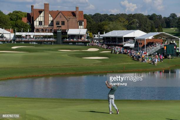 Tony Finau plays a shot on the 18th hole during the final round of the TOUR Championship the final event of the FedExCup Playoffs at East Lake Golf...
