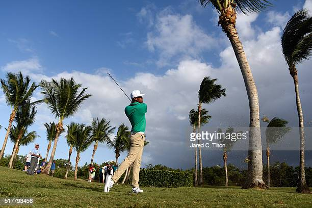 Tony Finau plays his second shot from the rough on the first playoff hole during the final round of the Puerto Rico Open at Coco Beach on March 27...