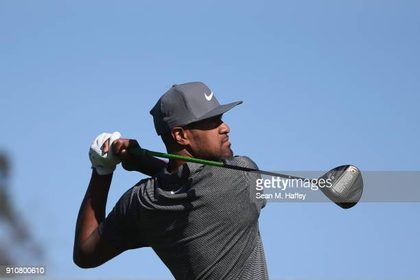 Tony Finau plays his shot from the eighth tee during the second round of the Farmers Insurance Open at Torrey Pines South on January 26 2018 in San...