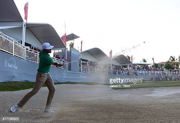 Tony Finau plays his third shot from the bunker on the third playoff hole during the final round of the Puerto Rico Open at Coco Beach on March 27...