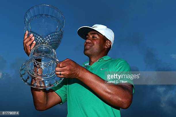 Tony Finau poses with the trophy after winning the Puerto Rico Open at Coco Beach on March 27 2016 in Rio Grande Puerto Rico