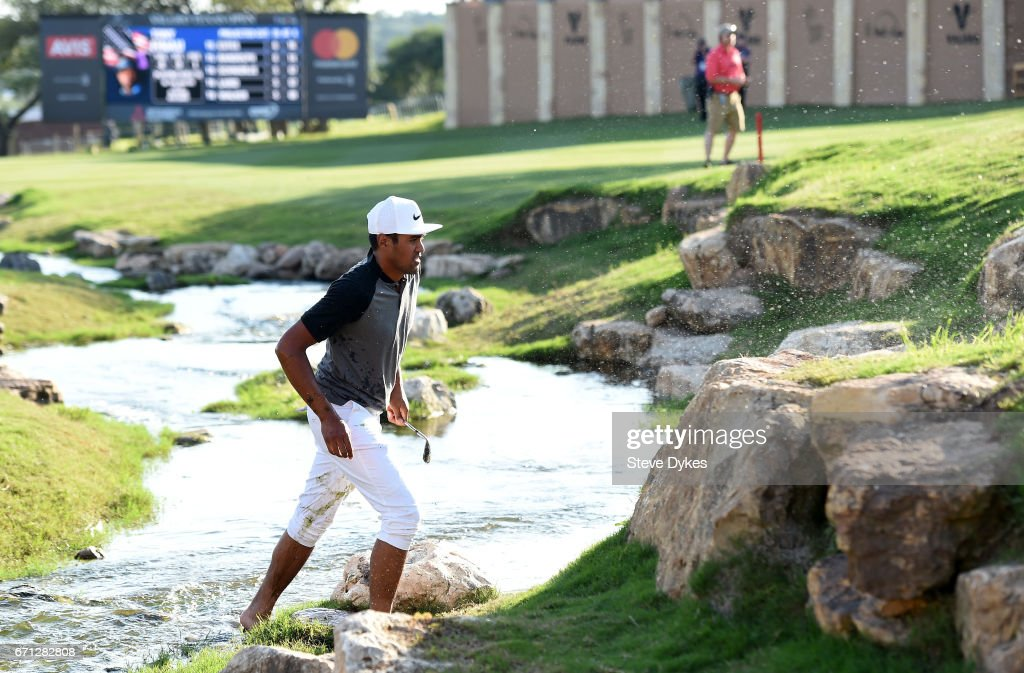 Tony Finau prepares to play his fourth shot out of the water hazard on the 18th hole during the second round of the Valero Texas Open at TPC San Antonio AT&T Oaks Course on April 21, 2017 in San Antonio, Texas.